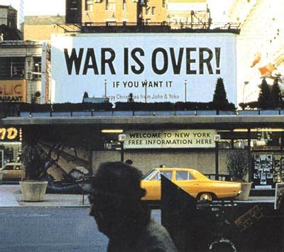This billboard says War is Over, If you want it, Happy